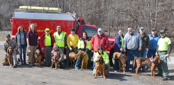 Participating in the Appalachian Bloodhound man-trailing training weekend were, from left:Andy Mantilla and Mazie; Tara Young, Annette Compton and Esther Lou; Michael Carpenter, DeWayne and Salina King and Ginger; Don Shelton and Winston; Michelle Mantilla and Findley; Michael Helms, Sandy Weik and Oliver; Rose and Paul Williams and Jed; Jim Hebb, Dave Sharp, and Dave Weik and Gunsmoke Festus. S. Stewart photo