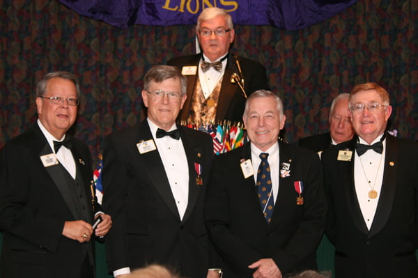 Durbin Lions Club member Charles Sheets was presented the International President's Award at the West Virginia Lions Club International convention. Attending the ceremony were, from left: Past International Director Larry Johnson, International Director Howard Hudson, Past International Director Stephen Glass [at podium], Sheets and Past International Director Robert Browning. Photo courtesy of J. D. Puckett