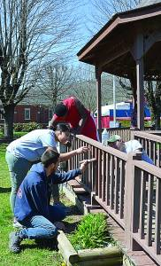 Jamal Sanchez, Lindsay Assem, Brad Swanson, and Pocahontas County Young Life Staff Associate David Moore spent their morning painting Marlinton's gazebo in preparation for the upcoming Great Greenbrier River Race. Assem, Sanchez, Swanson and the rest of their group traveled 14 hours from central Massachusetts to work in Pocahontas County for a week. C. D. Moore photo