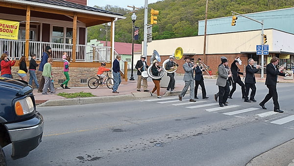 Prior to Their performance at the Pocahontas County Opera House Sunday evening, members of the High Street Jazz Band led concert goers and a few young bicyclists through downtown Marlinton in an authentic New Orleans style funeral parade. S. Stewart photo