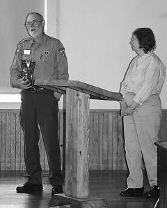 CVB President Mary Snyder listens as Droop Mountain Battlefield State Park Superintendent Mike Smith expresses his gratitude for being selected as the 2016 Tourism Person of the year. C. D. Moore photo