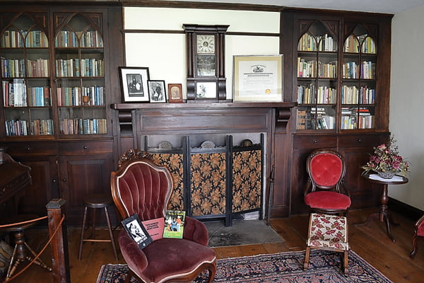 Photo by Suzanne Stewart The library and music room on the first floor of the Pearl S. Buck Birthplace has a welcoming, cozy atmosphere, complete with velvet-covered chairs, well-stocked book shelves and a Mason and Hamiln organ.