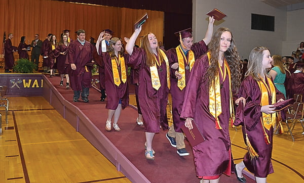 """After receiving their diplomas and becoming official graduates of Pocahontas County High School, the class of 2016 celebrates as they walk out of the gymnasium to the song """"Back Home,"""" by Andy Grammer. S. Stewart photo"""