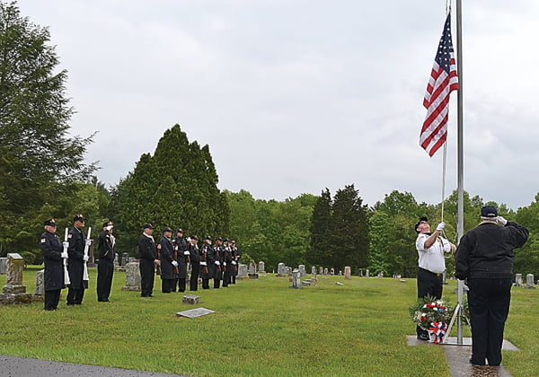 Members of the Pocahontas County Honor Corps stand at attention as the American flag is raised and lowered to half mast at the Memorial Day celebration Sunday at the Arbovale Cemetery. S. Stewart photo