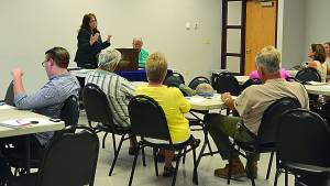 FaMIly reSourCe netWorK executive director laura young addresses a group at the Farmers Community Market interest meeting last tuesday. the project would bring a community co-op to Marlinton, where locals could buy and sell fresh, locally grown produce year-round. C.D. Moore photo