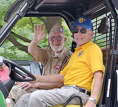 World War II veteran Don Jennings, left, served as the Durbin Days Heritage Festival Parade Marshal in the Grand Feature Parade Saturday. Charlie Sheets was his chauffeur. S. Stewart photo