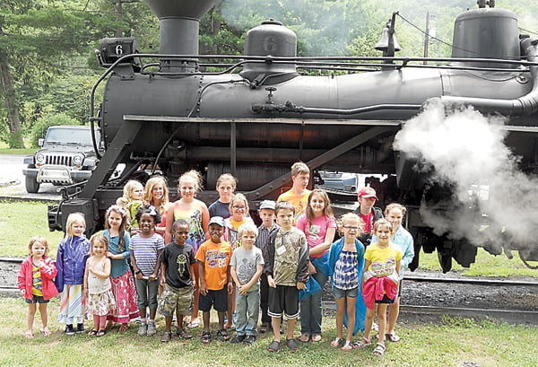 Twenty-two youngsters who participated in the summer reading program – On Your Mark, Get Set, Read! – at the Durbin and Linwood libaries were rewarded for their efforts with a ride on the Durbin Rocket last week. S. Stewart photo