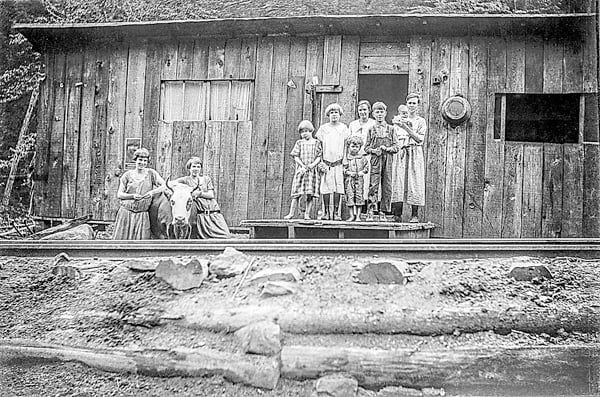 """The first in a series of books collecting the photography of West Virginia, """"Last Photographers –Finley Taylor, Collection 1 – Logging and Rails,"""" is filled with photographs of the lifestyles of families and woodhicks who worked for the Cherry River Boom and Lumber Company. Above, the photo titled """"Tub of Water,"""" is a family portrait of the Giles family. It is accompanied by a story which explains its title. Photo courtesy of Mark Romano"""