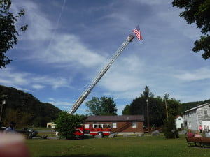 MEMBERS OF MARLINTON Fire Department and Rescue Squad were in attendance Sunday at the 9-11 ceremony. The American flag, coupled with the ladder of the fire turck, served as thought-provoking reminders of  September 11, 2001.