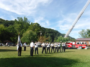MEMBERS OFTHEPocahontas County Veterans Honor Corps perform a 21-gun salute at Sunday's 9-11 Remembrance Ceremony. Pictured l to r: Harold Crist, Commander Rick Wooddell, Delmar Dove, Sam Arbogast, Steve Fierbaugh, Clyde White, Willard Pingley, Thomas VanReenan, Homer Hunter and Liz Gay. Bugler Donnie Waybright in back. J. Graham photos