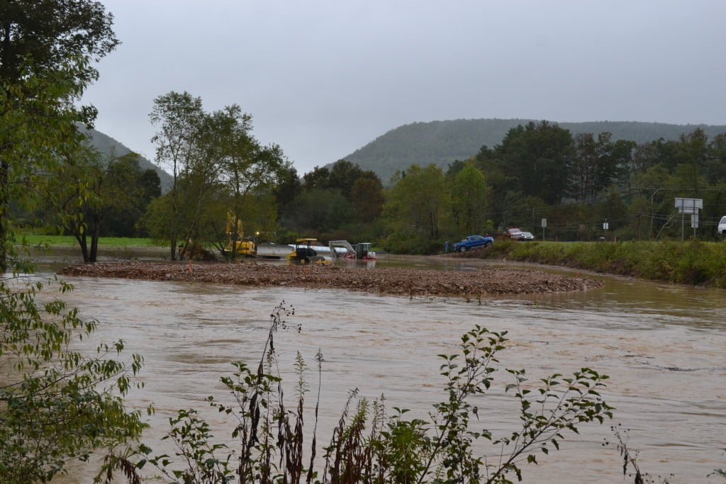 At the construction of a temporary bridge and road at the Huntersville intersection, the machinery was taken over by high water. S. Stewart photo
