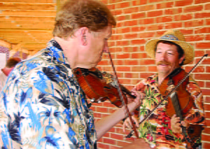 """Jay Lockman and Mike Burns """"fiddle around"""" at the Little Levels Heritage Fair."""