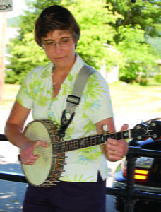Mary Sue Burns, left, plays the banjo at the Little Levels Heritage Fair in Hillsboro.