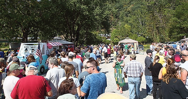 Long lines formed in front of the RoadKill Cook-off booths Saturday as visitors waited to taste the culinary creations found only at this one-of-a-kind festival. For more photos from the event, turn to page 10. Photo courtesy of Tom Walker