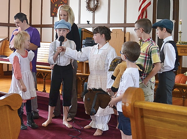 Dressed in period clothing and more modern attire, the youth of Dunmore United Methodist Church, with the help of adults Courtney Gainer and Ben Fuller, explained the differences between life in 1891 and today at the church's 125 anniversary celebration Sunday. From left: Khloe Gainer, Ben Fuller, Courtney Gainer, Luke Gainer, Olivia Hamilton, Reed Garber, Wade Garber and Aaron Hamilton. S. Stewart photo
