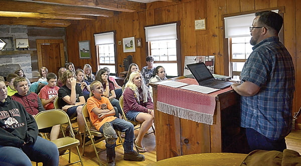 Writer and playwright Eric Fritzius, right, led a writing workshop at the Pearl S. Buck Birthplace last week for eighth grade students from Green Bank Elementary-Middle School. Fritzius taught the students how to draw from life experiences to create entertaining stories. S. Stewart photo