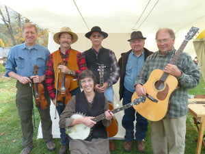 Photo courtesy of Mary Sue Burns Juanita Fireball and the Continental Drifters at Huntersville Tradition Day. Pictured standing, l to r: Jay Lockman, Mike Burns, John Sparks, Wayne Walton and Terry Richardson. Seated: Mary Sue Burns.