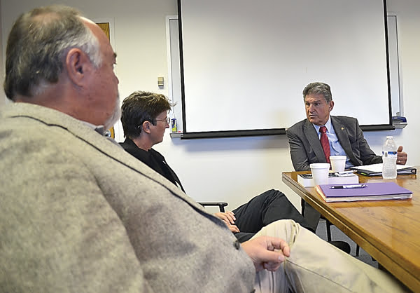 US Senator Joe Manchin, right, visited the Green Bank Observatory last week to discuss the future of the facility with business manager Mike Holstine, left , and director Karen O'Neil. S. Stewart photo