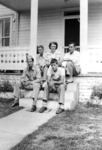 """THEARNDTWHITEfamily on the steps of the """"White house"""" at Minnehaha Springs. During deer season, hunters would be welcomed into the home to join the family for a few days. Pictured, front, l to r: Max White and Lee White; back row,         l to r: Rex White, Edna and Arndt White. Photo courtesy of Rene White"""