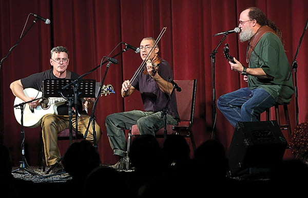 Photo courtesy of Tom Walker On October 23, 2016, Pocahontas County musicians took to the stage at the Opera House to pay tribute to businessman, friend  and fellow musician Terry Richardson. The Elk River Ramblers, from left, Seth Maynard, Paul Marganian and Galen Watts performed songs in memory of their bandmate.
