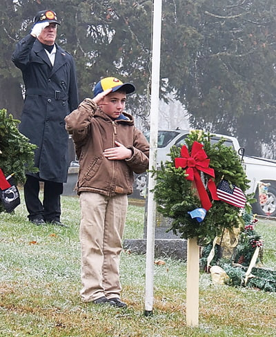 Cub Scout Kyle Kelk –with Wooddell in the background –salutes after placing a wreath at the Mountain View cemetery. Photos courtesy of Gail Hyer