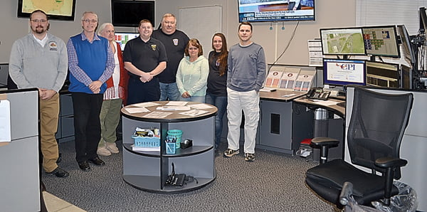 Standing in the newly remodeled 911 Dispatch Center from left: 911 director Michael O'Brien, Alvon Ryder, Carol Smallridge, deputy director Travis Cook, Jeff Jackson, Angie Wilfong, Bridget Shaw and Jonathan Moore. S. Stewart photo