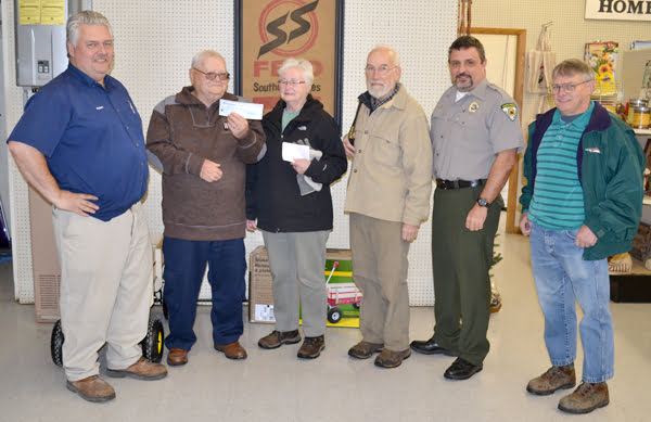 Southern States - Marlinton Co-op Manager Robert Lee, left, presented a check for $500 to Watoga Foundation board member Alfred Dean, Jr. for the foundation's proposed putt-putt course at the state park. Pictured, l to r: Lee, Dean, Mary Dawson, David Elliott, Jody Spencer and Frankie Hammons. S. Stewart photo