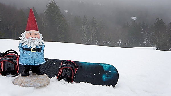 The Travelocity Roaming Gnome visited Pocahontas County last week and took in the sights at several winter hotspots, including Snowshoe Mountain Resort, where he tried snowboarding. Photo courtesy of Travelocity