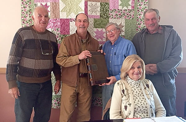 Pocahontas County Historic Landmarks Commission pose with two books of historic records donated for preservation. From left, Dennis Driscoll, Bob Sheets, Jason Bauserman, Ruth Taylor and Tim Wade.