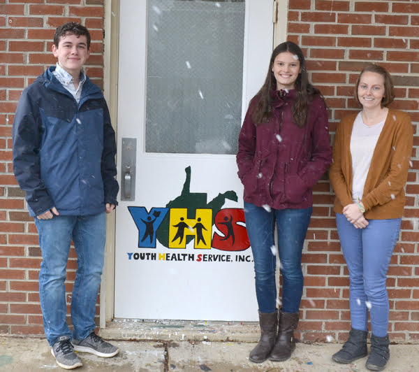 Youth Health Services, Inc., Pocahontas County office is located in the annex building at Pocahontas County High School. Family Service Specialist Kendra Taylor, right, stands with juniors Hunter Tankersley and Laura Leyzorek, who painted the organization's logo on the office door. S. Stewart photo