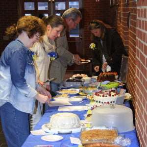 Judges in last Friday's Pack 33 Bake Off Challenge sample the goods prepared for the competition. Jeft to right: Shirley Meadows, Sarah Riley, David Merryman and Kelly Smith.
