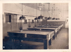 """TABLESWAITINGFOR action in the old poolroom on Main Street in Marlinton.  The """"quiet"""" of this photo is in sharp contrast to the memories of the cracking and pinging of pool balls and pin ball machines. Michael McMann, of Great Falls, Montano, still remembers, after all these years, that there were five pool tables. Photo courtesy of Ken Nottingham"""