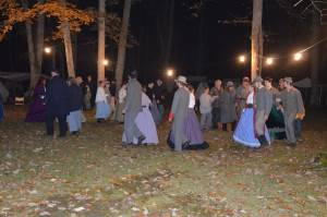 Re-enactors and guests circle the dance floor in the Grand March during the ball Saturday night as part of the re-enactment activities at Droop Mountain Battlefield State Park. C. Moore photos