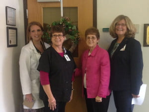 POCAHONTAS MEMORIAL HOSPITAL held its annual Breast       Cancer Awareness Day October 20. Pictured at the wreath hanging ceremony are, l to r: Donna Lydel-Burley, FNP, Radiology Department         Supervisor Cheryl Cain, Barbara Campbell and PMH CEO Barbara Lay. Photo courtesy of PMH